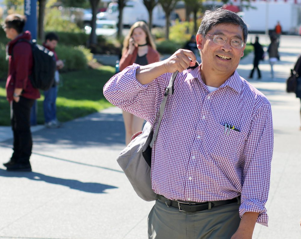 PCC President Mark Mitsui strolls the Southeast Campus on Monday, Sept. 26.