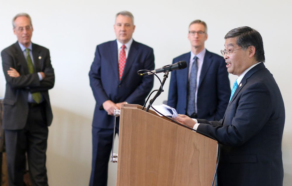 PCC President Mark Mitsui talks to reporters about the impact of the historic collaboration as PSU President Wim Wievel, OHSU President Joseph Robertson and City mayor Ted Wheeler look on.