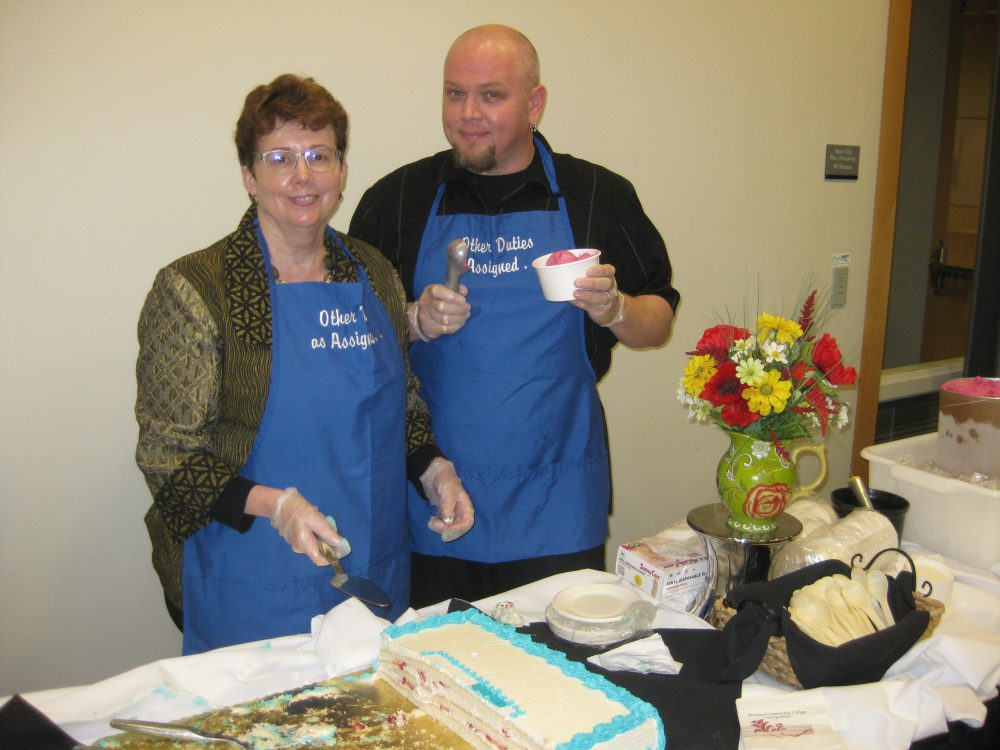 Cheryl Scott, dean of Instruction at Rock Creek, serves up some birthday cake with staff.