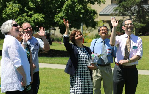 U.S. Rep. Suzanne Bonamici waves at Zippy the Drone with Rock Creek staff and Campus President Sandra Fowler-Hill (left). On the far right is Michael Altman, Division Dean of Science & Technology at the campus.