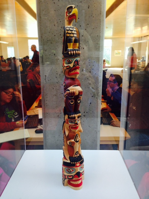 A small replica of Richard Hunt's Welcome Pole is housed in the PCC Sylvania library. It offers an intimate look at all of the totem's images.